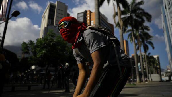 Protestante en Caracas, Venezuela - Sputnik Mundo