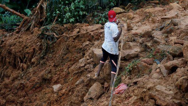 Consecuencias del diluvio en Sri Lanka - Sputnik Mundo