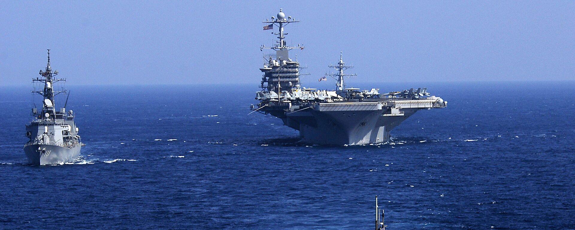 El submarino estadounidense USS Seawolf, junto al portaviones USS John C. Stennis y el destructor japonés JS Oonami, 12 de febrero de 2009 - Sputnik Mundo, 1920, 29.05.2017