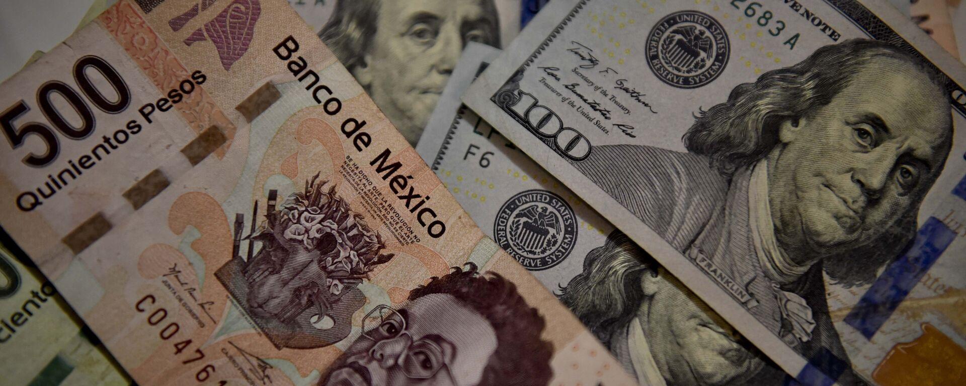 Peso mexicano y dólar estadounidense - Sputnik Mundo, 1920, 28.09.2021