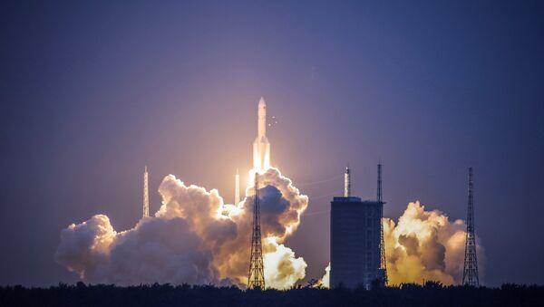 Lanzamiento del cohete pesado chino Larga Marcha 5 - Sputnik Mundo