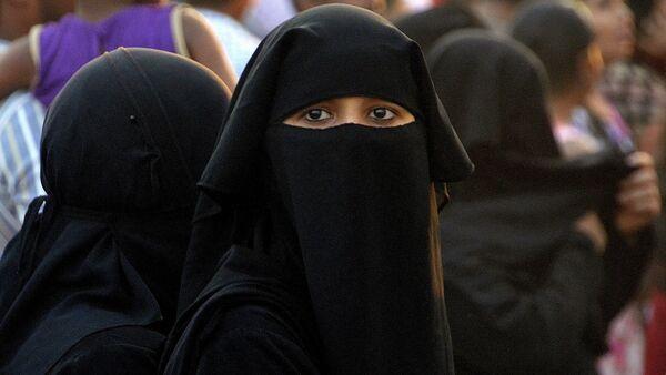 Una mujer musulmana - Sputnik Mundo