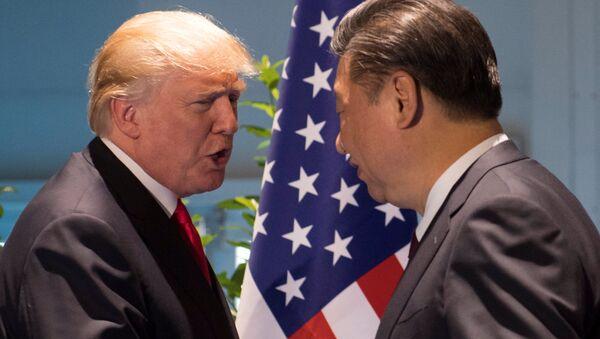 Presidente de EEUU, Donald Trump, y su homólogo chino, Xi Jinping - Sputnik Mundo