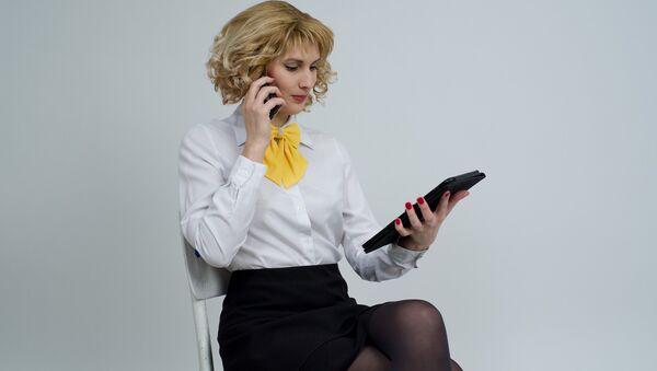 Una mujer de negocios (imagen referencial) - Sputnik Mundo