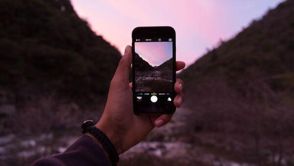 Un iPhone (imagen referencial) - Sputnik Mundo