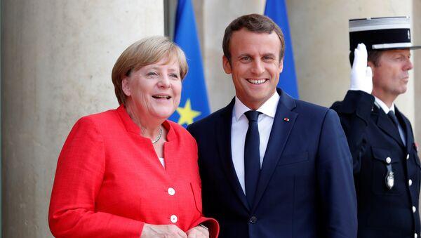 La canciller alemana, Angela Merkel, el presidente de Francia, Emmanuel Macron - Sputnik Mundo
