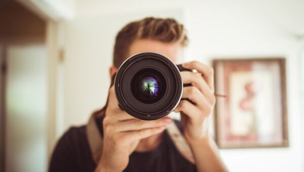 Un fotógrafo (archivo) - Sputnik Mundo