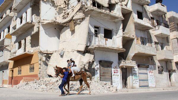 Niños en la ciudad siria de Idlib - Sputnik Mundo