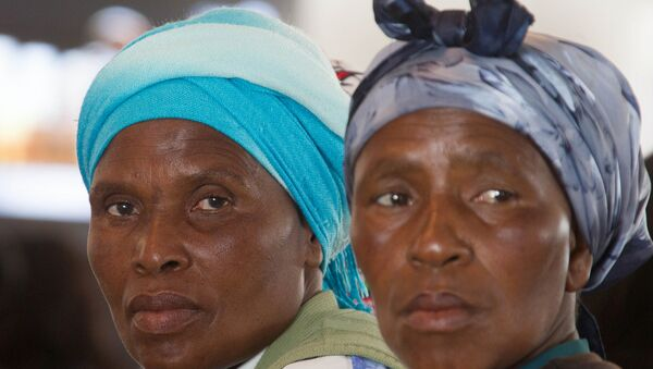 Mujeres de piel negra (imagen ilustrativa) - Sputnik Mundo