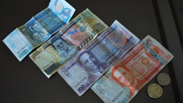 Pesos filipinos - Sputnik Mundo