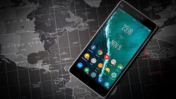 Teléfono móvil (imagen referencial) - Sputnik Mundo