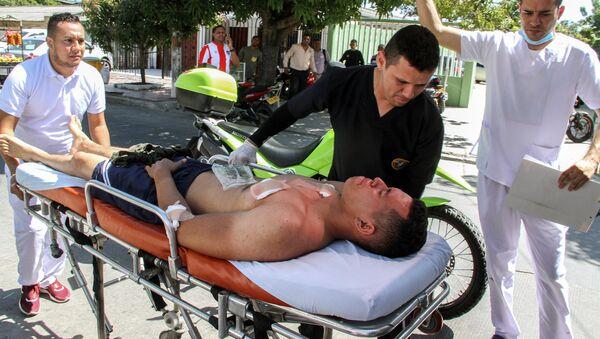 Un policía herido en el atentado contra una estación de Policía en Barranquilla, Colombia - Sputnik Mundo