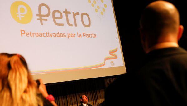 Logo de la criptomoneda venezolana, petro - Sputnik Mundo
