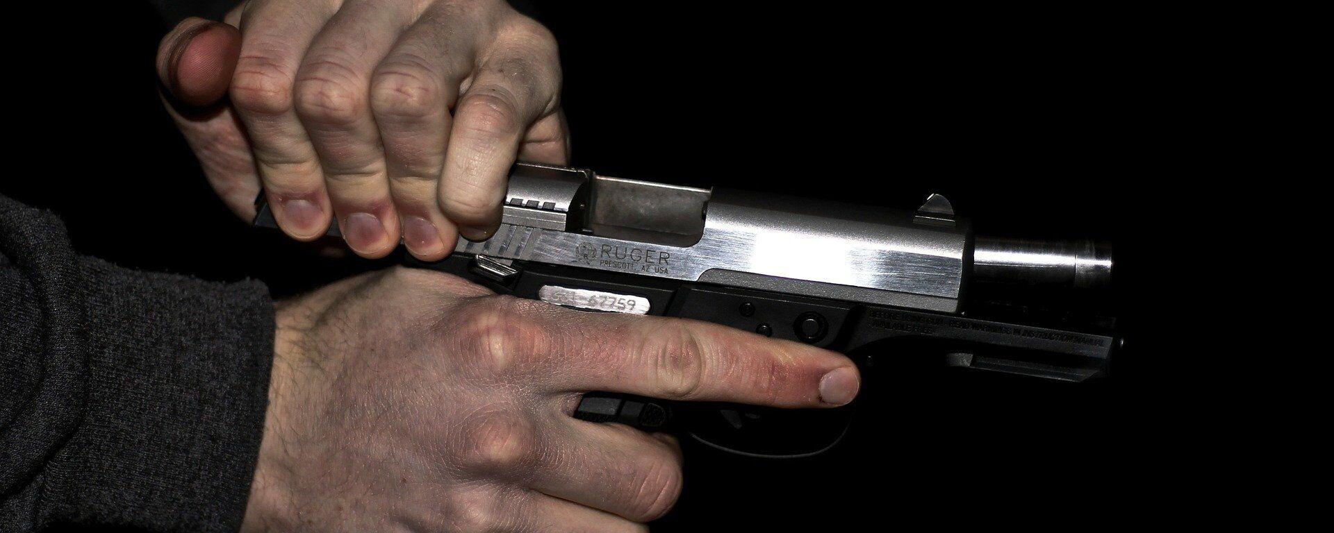 Una pistola (imagen referencial) - Sputnik Mundo, 1920, 27.08.2021
