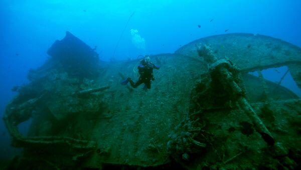 Un barco naufragado, imagen referencial - Sputnik Mundo