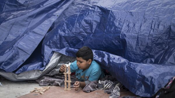 Niños migrantes - Sputnik Mundo