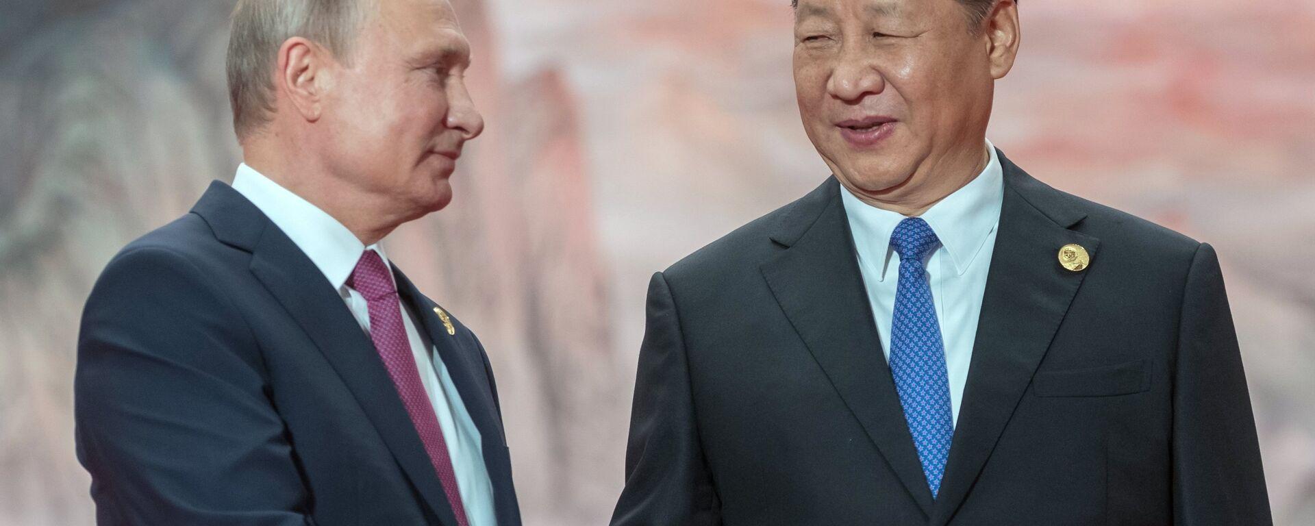 Presidente de Rusia, Vladímir Putin, y presidente de China, Xi Jinping - Sputnik Mundo, 1920, 25.08.2021