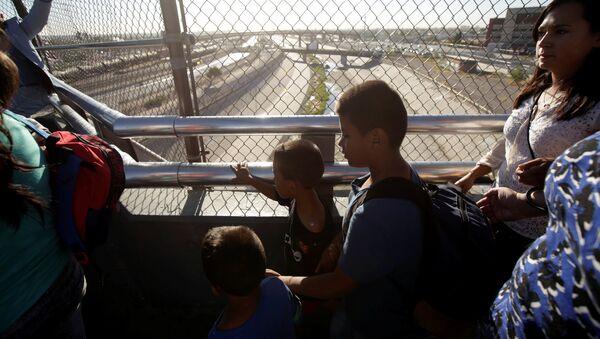 Migrantes en la frontera con EEUU - Sputnik Mundo