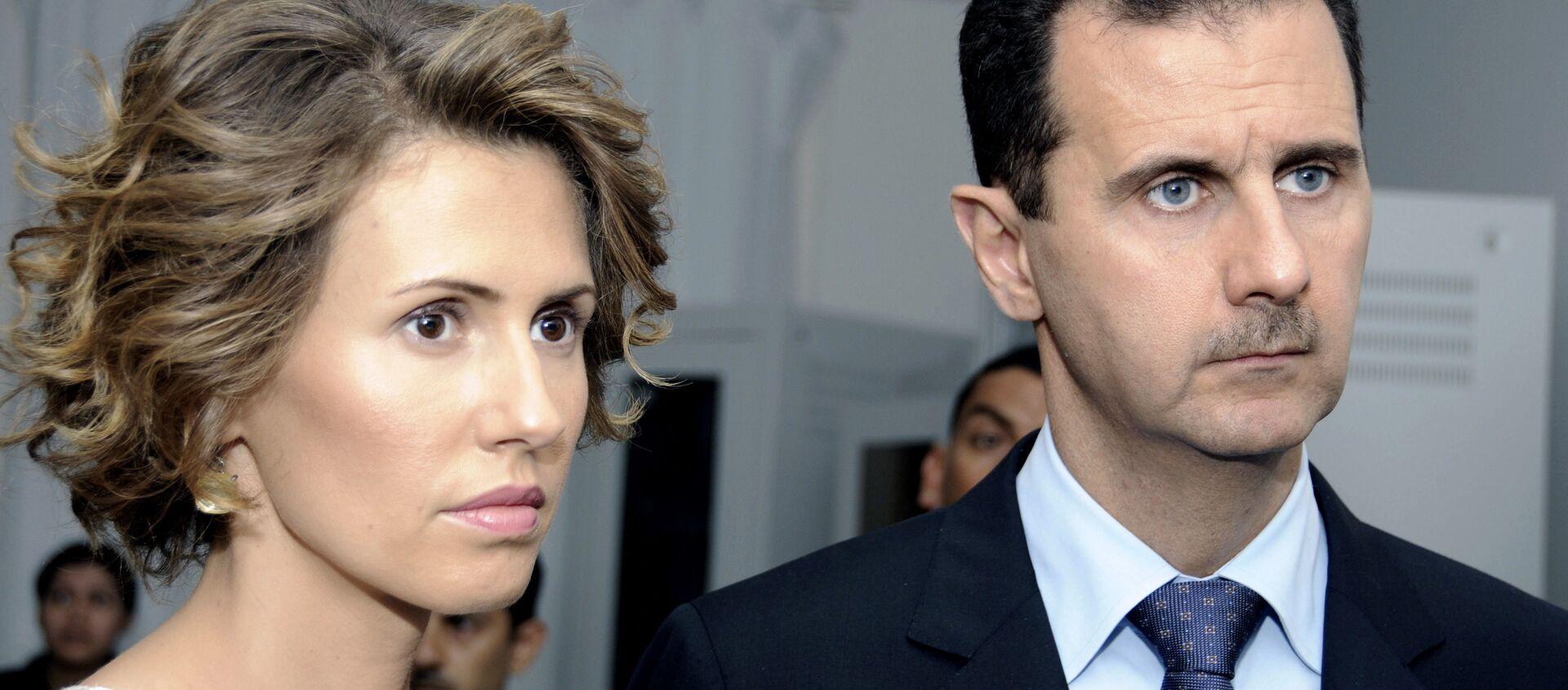 Asma Asad, primera dama siria, al lado de su marido, el presidente Bashar Asad - Sputnik Mundo, 1920, 17.06.2020