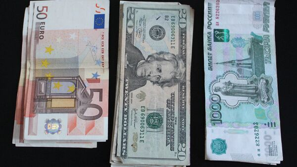 Euros, dólares y rublos - Sputnik Mundo