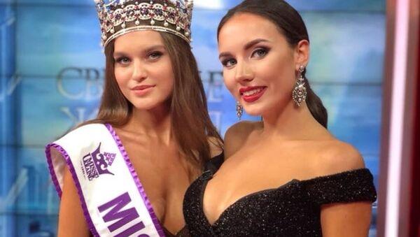Leonila Guz, nueva Miss Ucrania 2018,  junto con Victoria Kiose, Miss Ucrania 2016 - Sputnik Mundo