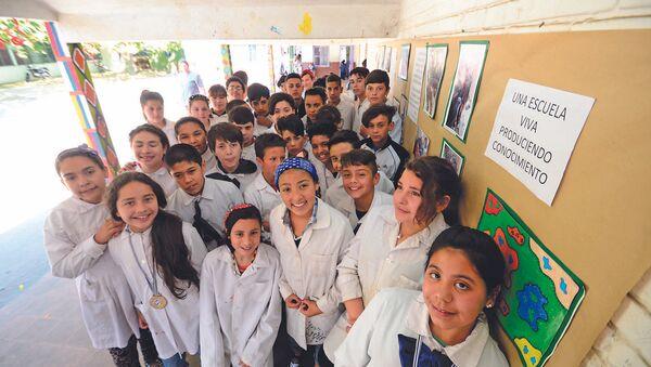 Alumnos de la escuela N° 319 de Montevideo, Uruguay, integrantes del proyecto Entre bichitos - Sputnik Mundo