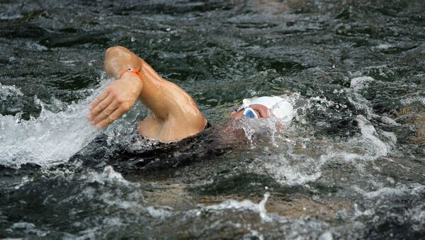 Un nadador, foto archivo - Sputnik Mundo