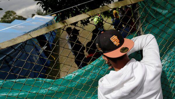 Un migrante venezolano en Colombia - Sputnik Mundo