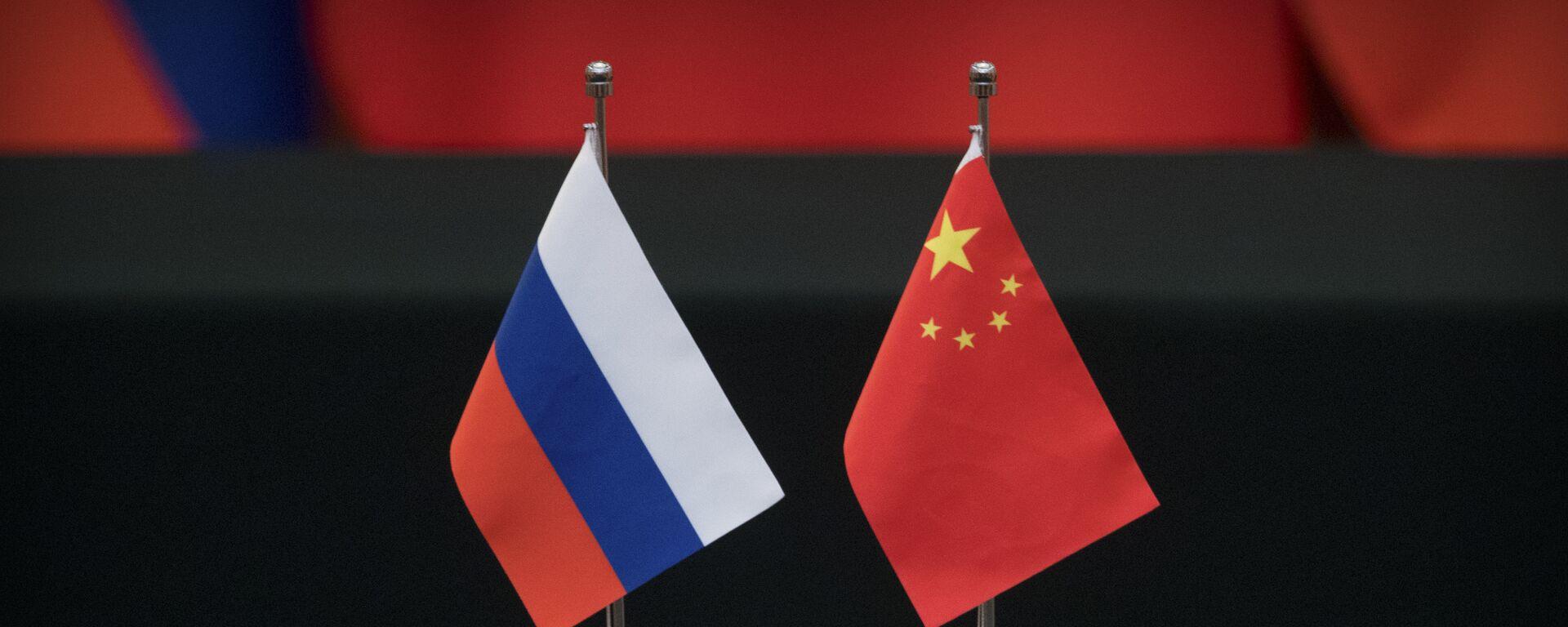 Las banderas de Rusia y China - Sputnik Mundo, 1920, 06.10.2021