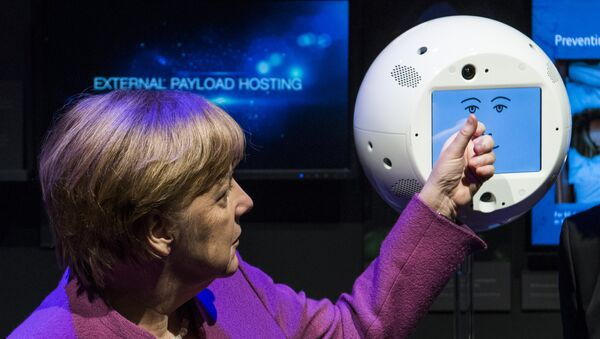 Angela Merkel con el robot CIMON - Sputnik Mundo