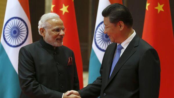 El primer ministro indio, Narendra Modi, y el presidente chino, Xi Jinping - Sputnik Mundo