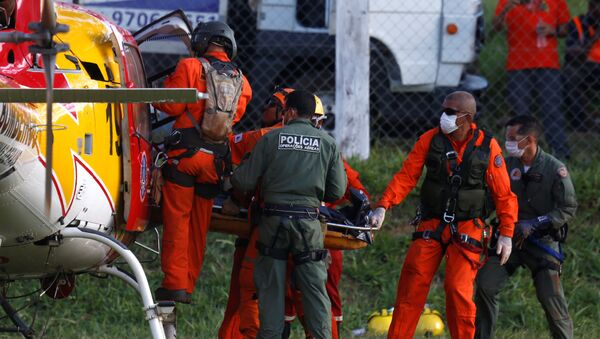 Cuerpo de la victima de la rotura de una represa en Brumadinho - Sputnik Mundo