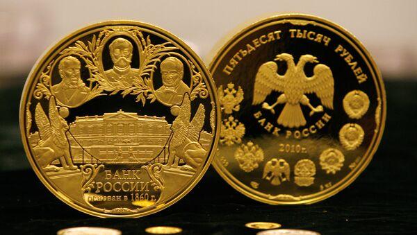 Unas monedas de oro del Banco de Rusia (archivo) - Sputnik Mundo
