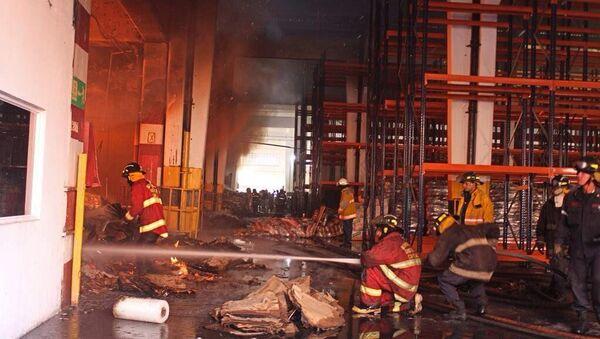 Incendio en un depósito de alimentos en Vargas, Venezuela - Sputnik Mundo