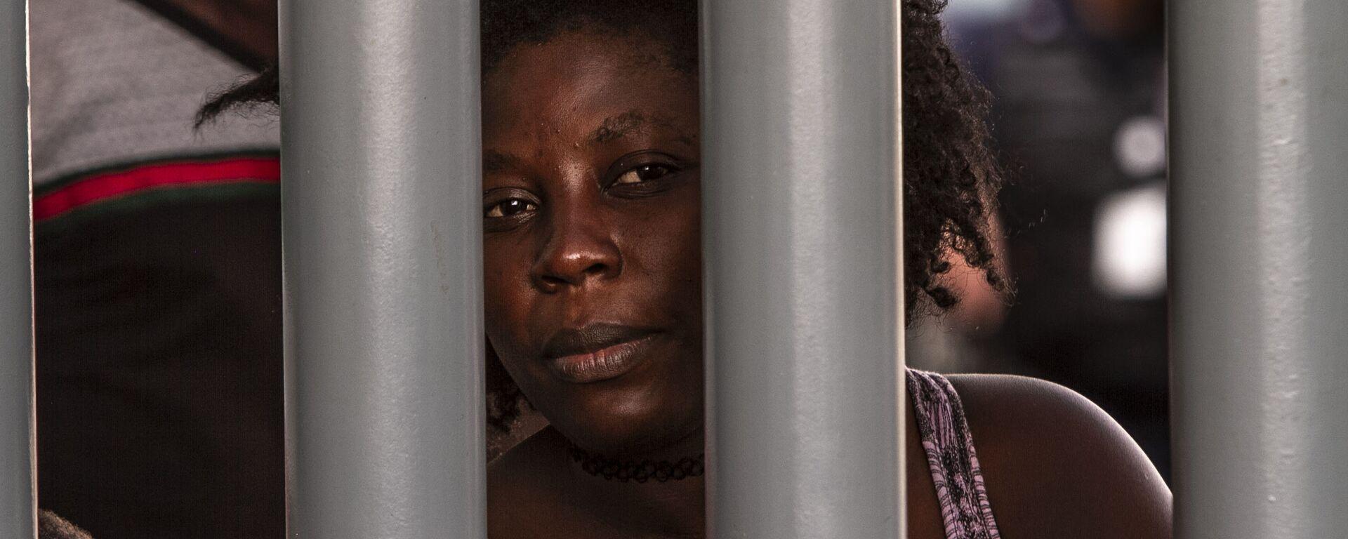 Tapachula, Chiapas: Mujer haitiana espera que le resuelvan su situación migratoria en la Estación Siglo XXI - Sputnik Mundo, 1920, 19.04.2019