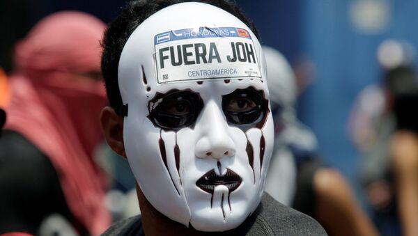 Una protesta antigubernamental en Honduras - Sputnik Mundo