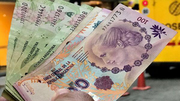 Los pesos argentinos - Sputnik Mundo