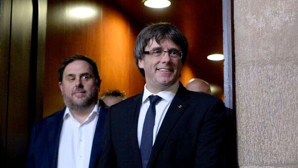 Exdirigentes catalanes Oriol Junqueras y Carles Puigdemont  - Sputnik Mundo