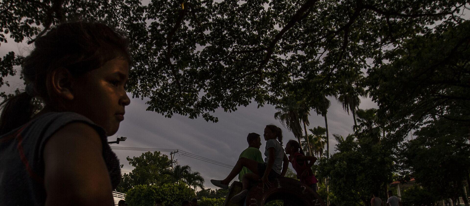 Con más de tres semanas en espera en la resolución de solicitud de refugio en México, migrantes centroamericanos permanecen en la calle durante el día internacional de las personas refugiadas, archivo, 2019. - Sputnik Mundo, 1920, 28.01.2021