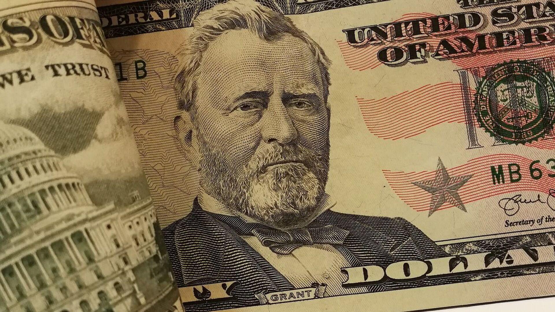 Un dólar (imagen referencial) - Sputnik Mundo, 1920, 20.09.2021