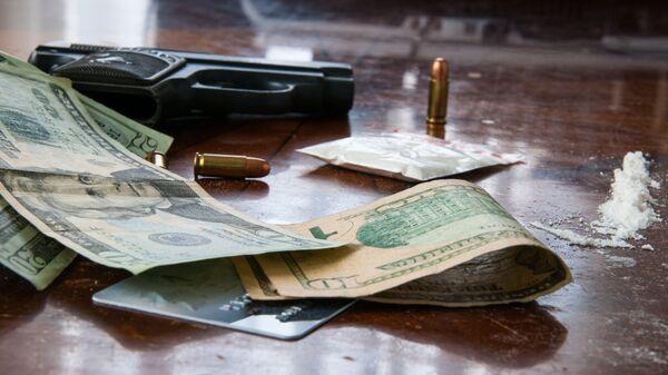 Cocaína, dólares y balas - Sputnik Mundo