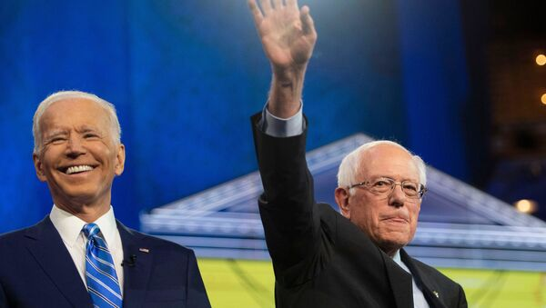 Democratic presidential primary candidates Vice President Joe Biden and Sen. Bernie Sanders greet the audience from the debate stage Thursday, June 27, 2019, at the Adrienne Arsht Center for the Performing Arts in Miami. Tcn Debate - Sputnik Mundo