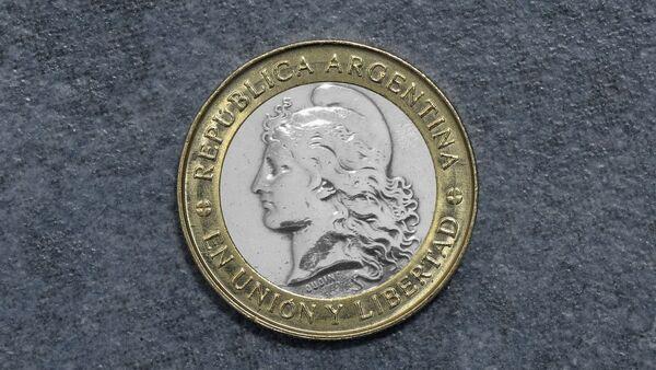 Peso argentino (imagen referencial) - Sputnik Mundo