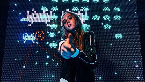 Una 'gamer', imagen referencial - Sputnik Mundo