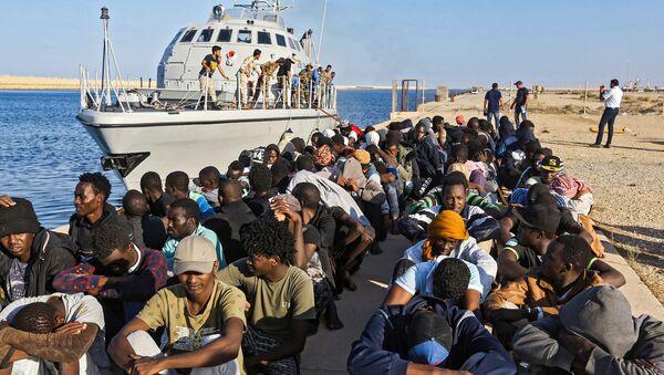 Migrantes de Libya - Sputnik Mundo