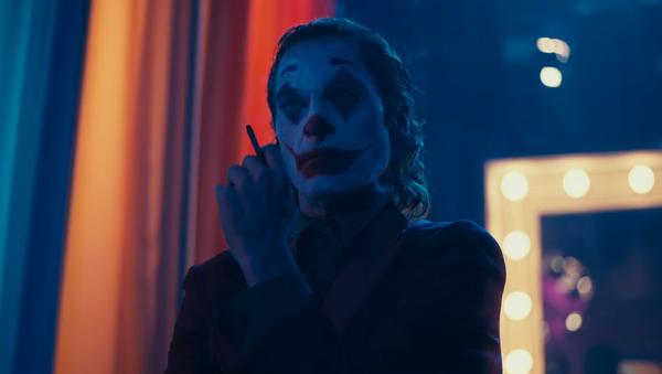El actor Joaquin Phoenix en el papel del personaje Guasón —Joker— - Sputnik Mundo