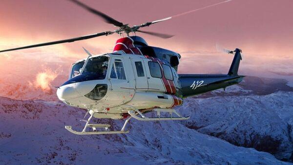 Un helicóptero tipo Bell 412 (imagen referencial) - Sputnik Mundo