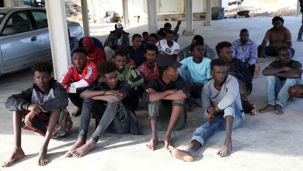 Migrantes libios - Sputnik Mundo