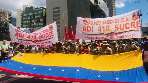 Miembros de ADI 416 manifestándose en Caracas a favor de Evo Morales y contra el golpe de estado en Bolivia - Sputnik Mundo