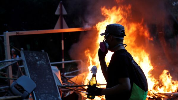 Un manifestante en Hong Kong (imagen referencial) - Sputnik Mundo